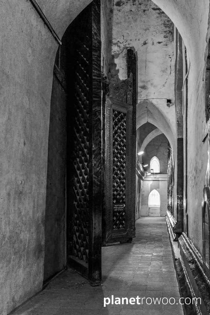 Ananda temple interior corridor with large teak doors