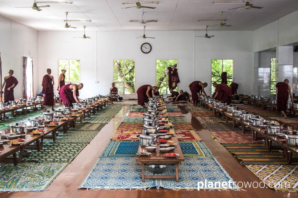 Novice monks prepare the dining hall in a Mandalay monastery