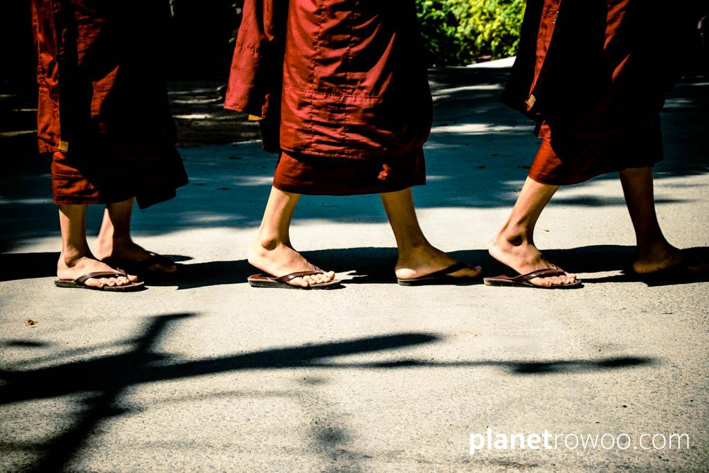 Monks maroon robes and flip-flopped feet in the lunchtime queue at a Mandalay monastery