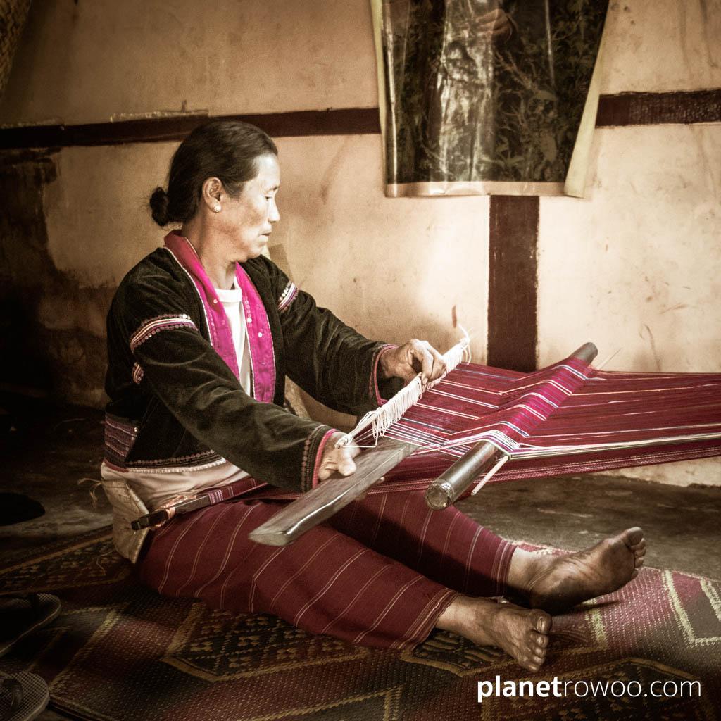 Palaung villager demonstrating traditional handloom
