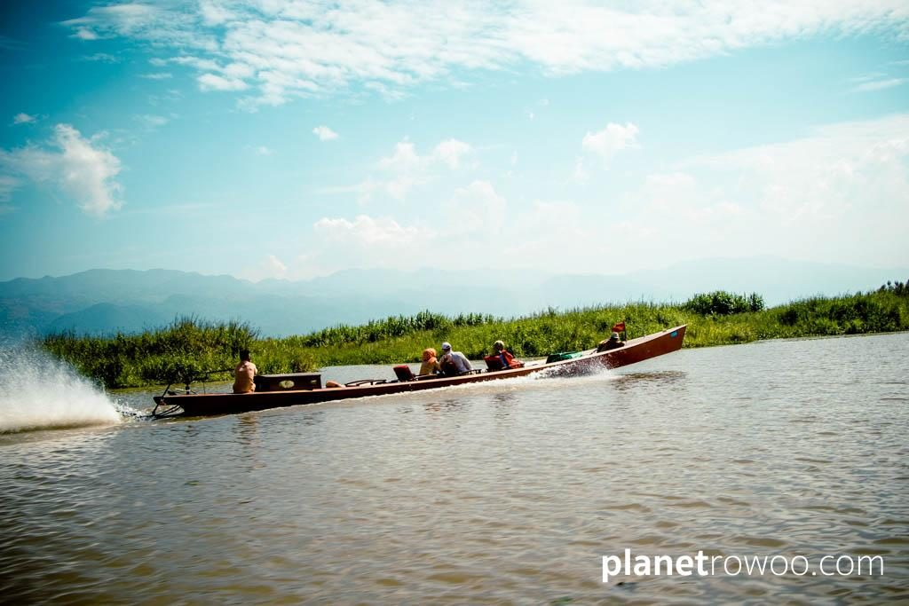 Tourist motorboat with the Shan hills in the background