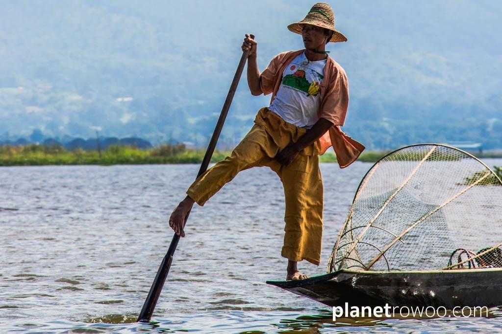 Inle Lake fisherman using his leg to row his boat