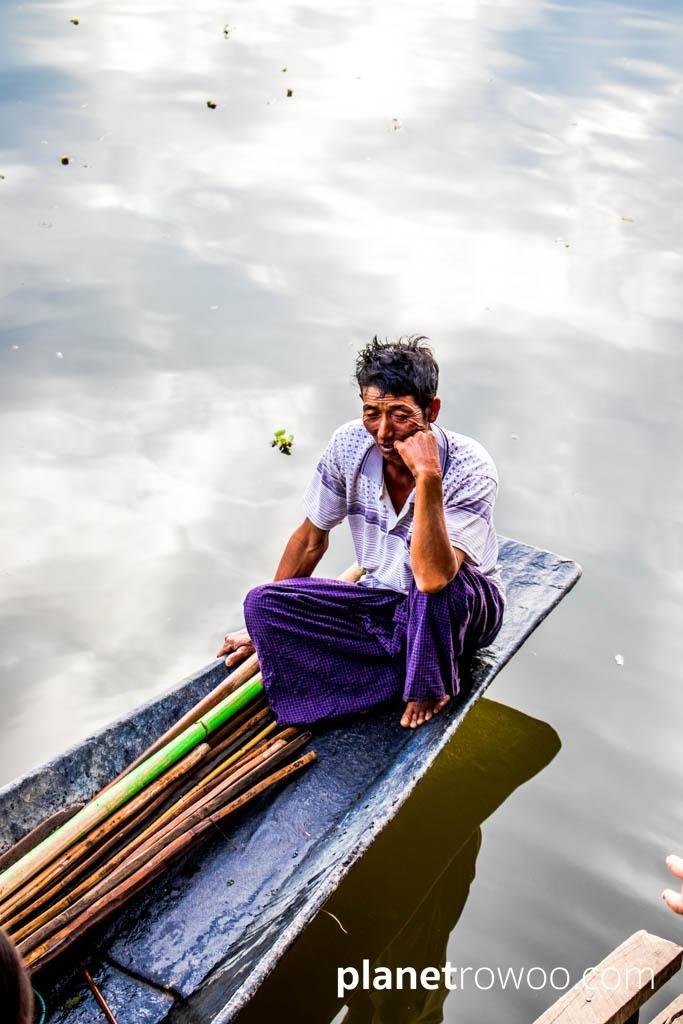 A fisherman relaxes outside Nga Phe Kyaung Monastery