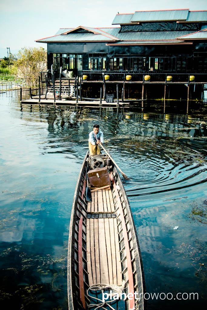 Inle Lake boatsman approaching a jetty