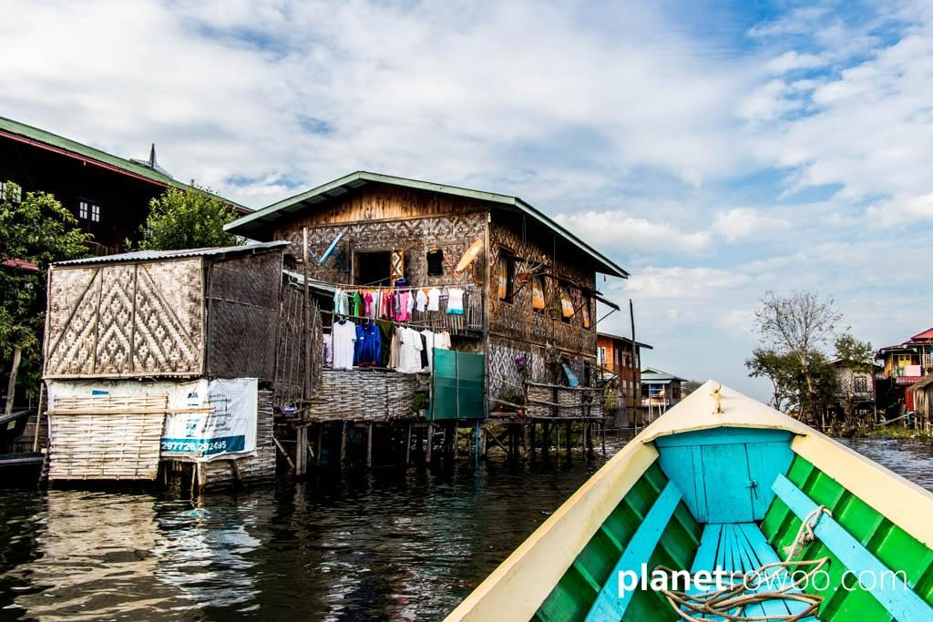 Passing a village house on Inle Lake