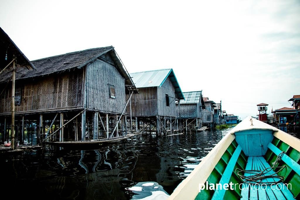 Passing village houses of Inle Lake
