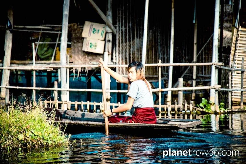 A rowing boat is the only way to travel for this Inle Lake village girl