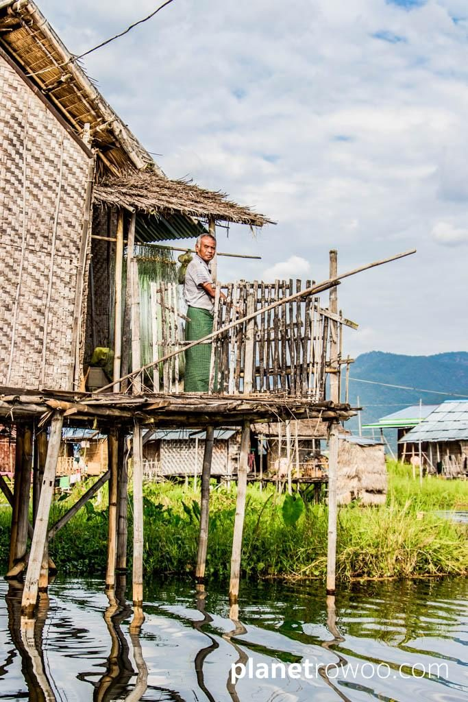 An Inle Lake villager looks on from his 'balcony'