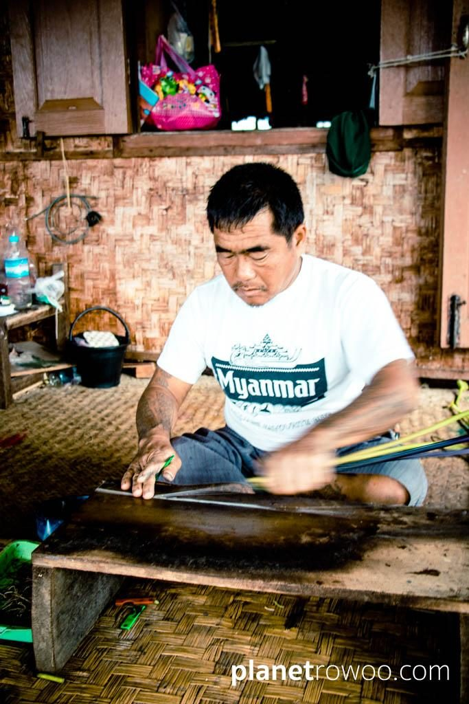 Extracting threads from the lotus plant, Inpawkhone weaving village