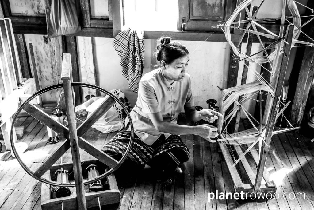 Spinning the silk thread on a spinning wheel, Inpawkhone weaving village