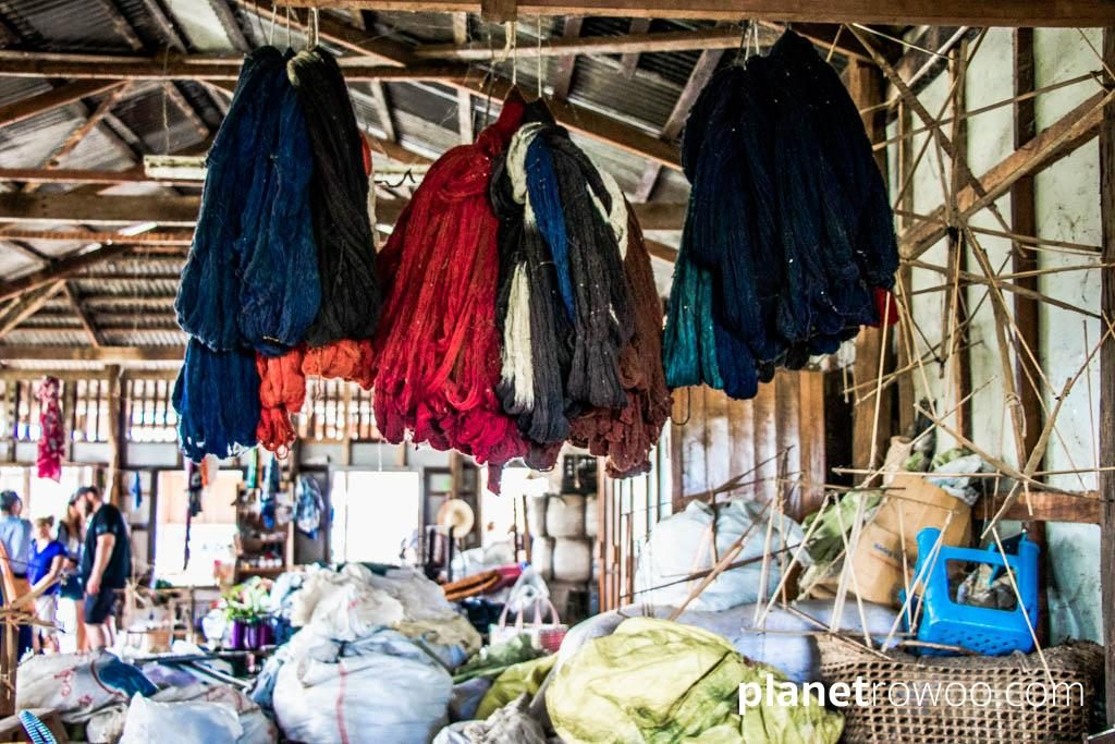 Hand-dyed lotus yarn hanging in the weaving factory, Inpawkhone weaving village