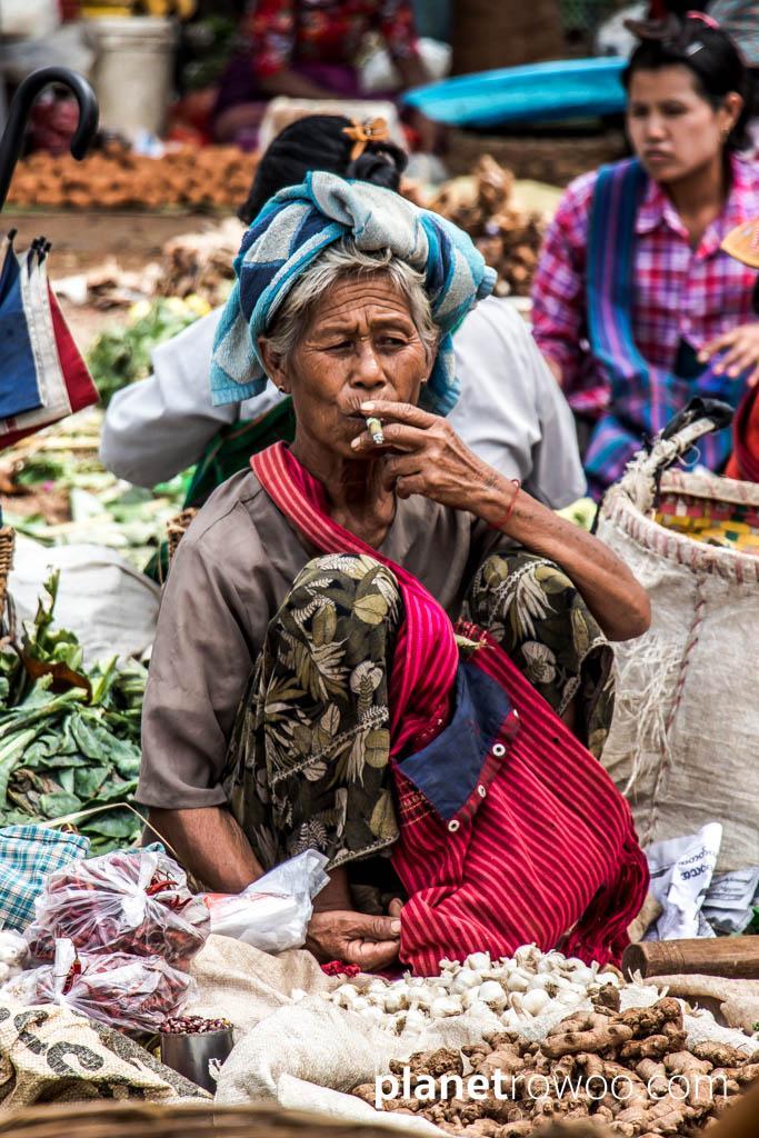 Smoking a cheroot at Mingalar Market, Nyaung Shwe