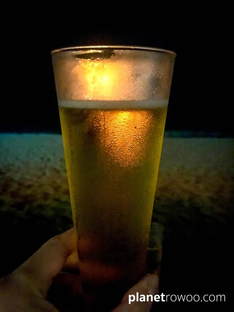 A late evening ice-cold beer at the Beach Bar
