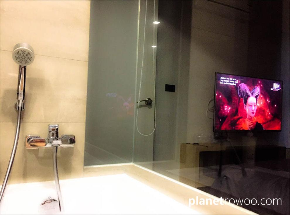 Hotel vibes at PLAY Condo: Watch your bedroom TV from the bath!