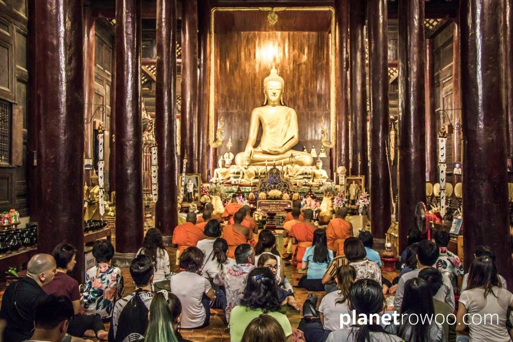 Monks, Buddhists and western visitors gather together for Makha Bucha at Wat Phan Tao