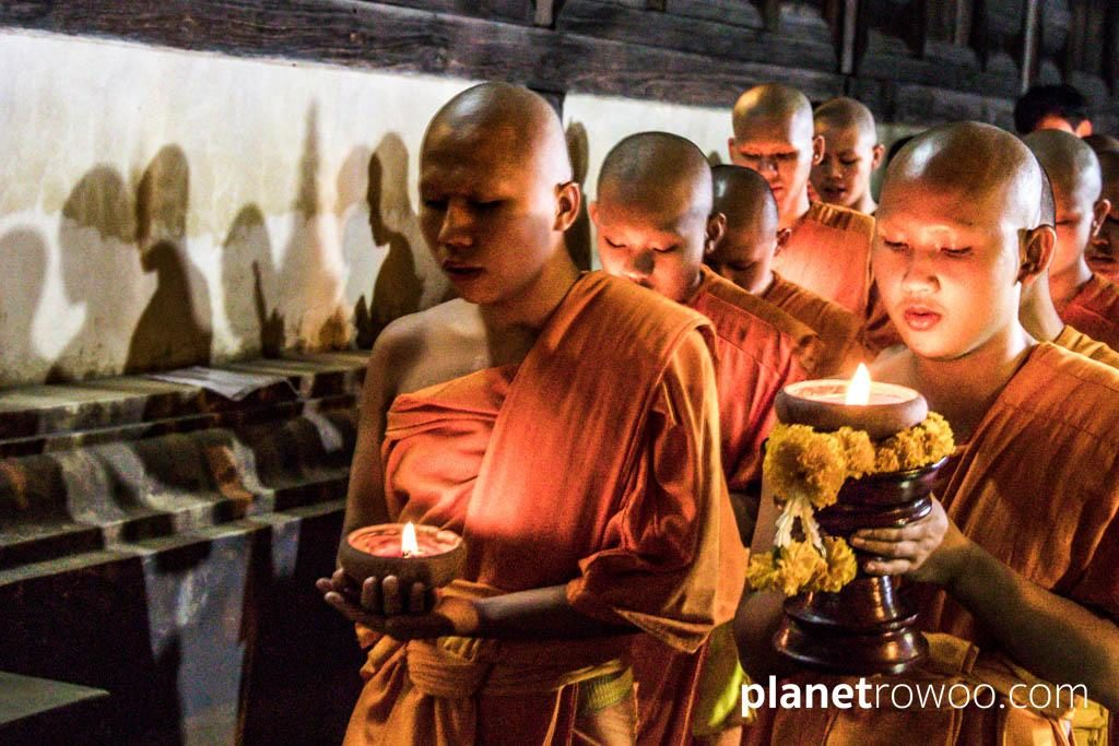 Monks perform the wian tian candlelight procession at Wat Phan Tao