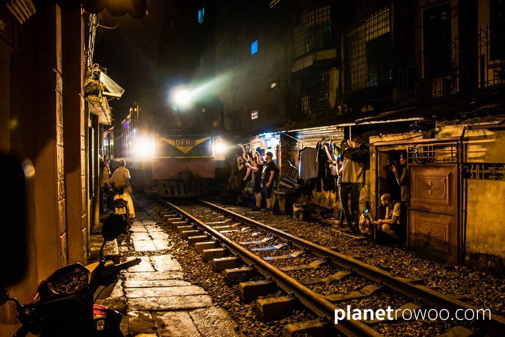 An evening train passes through Train Street in Hanoi Old Quarter