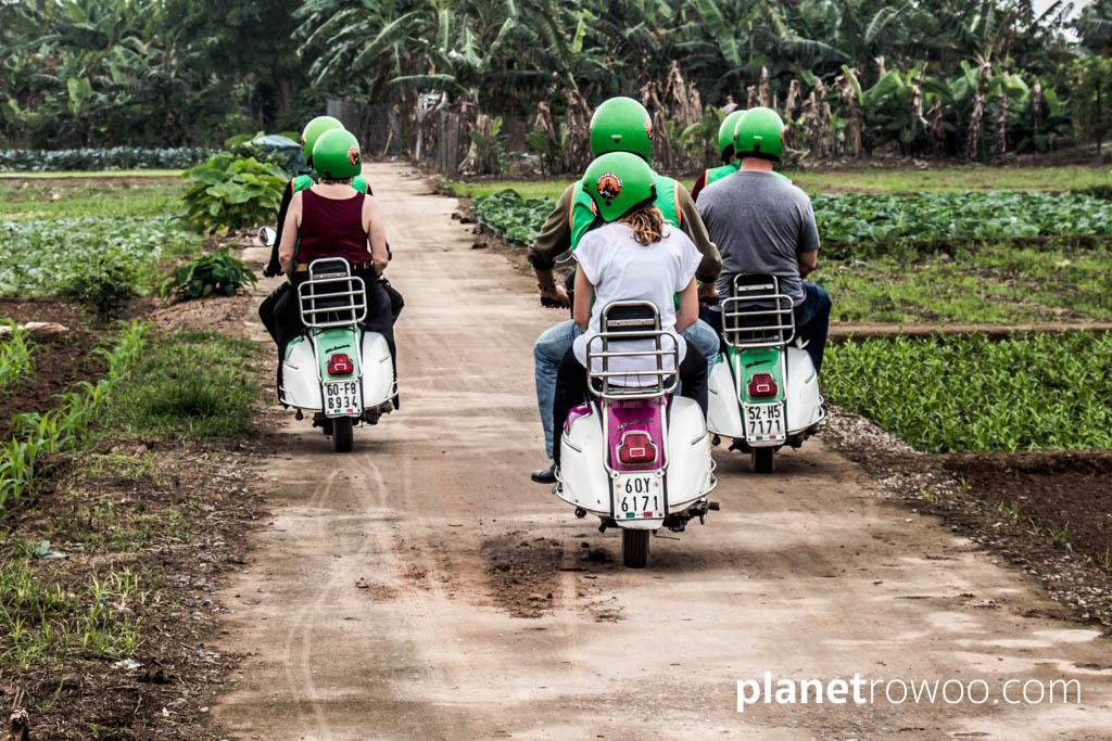 Passing another Hanoi motorbike tour on Banana Island