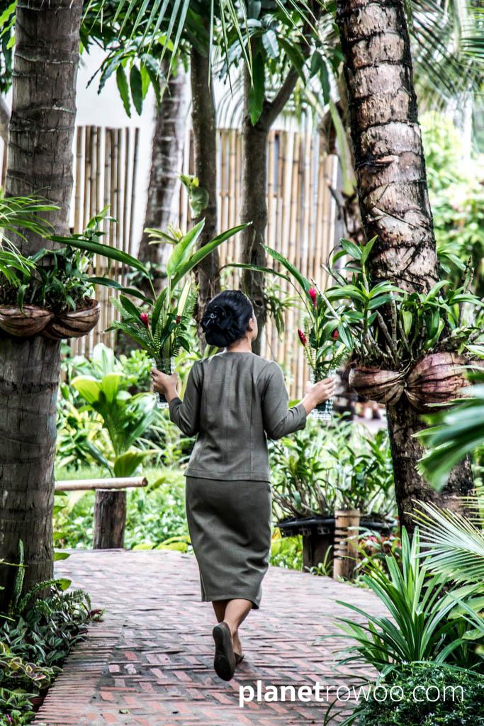 A staff member carries some fresh cuttings from the tropical gardens at Maison Dalabua