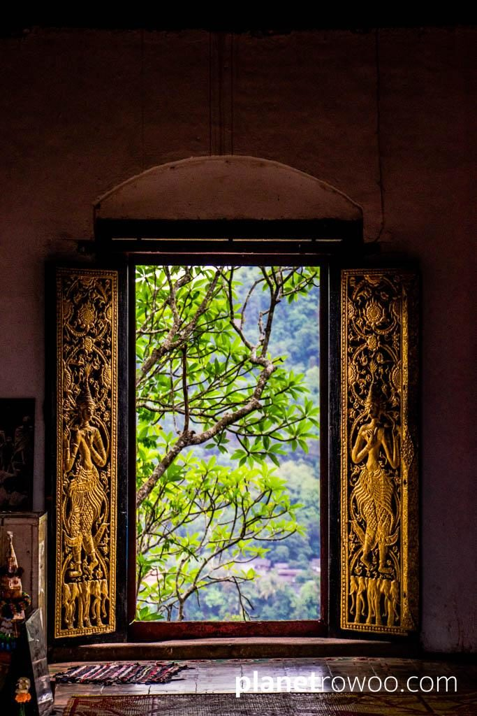 View through the gilded doorway of the hilltop Wat Chomsi temple