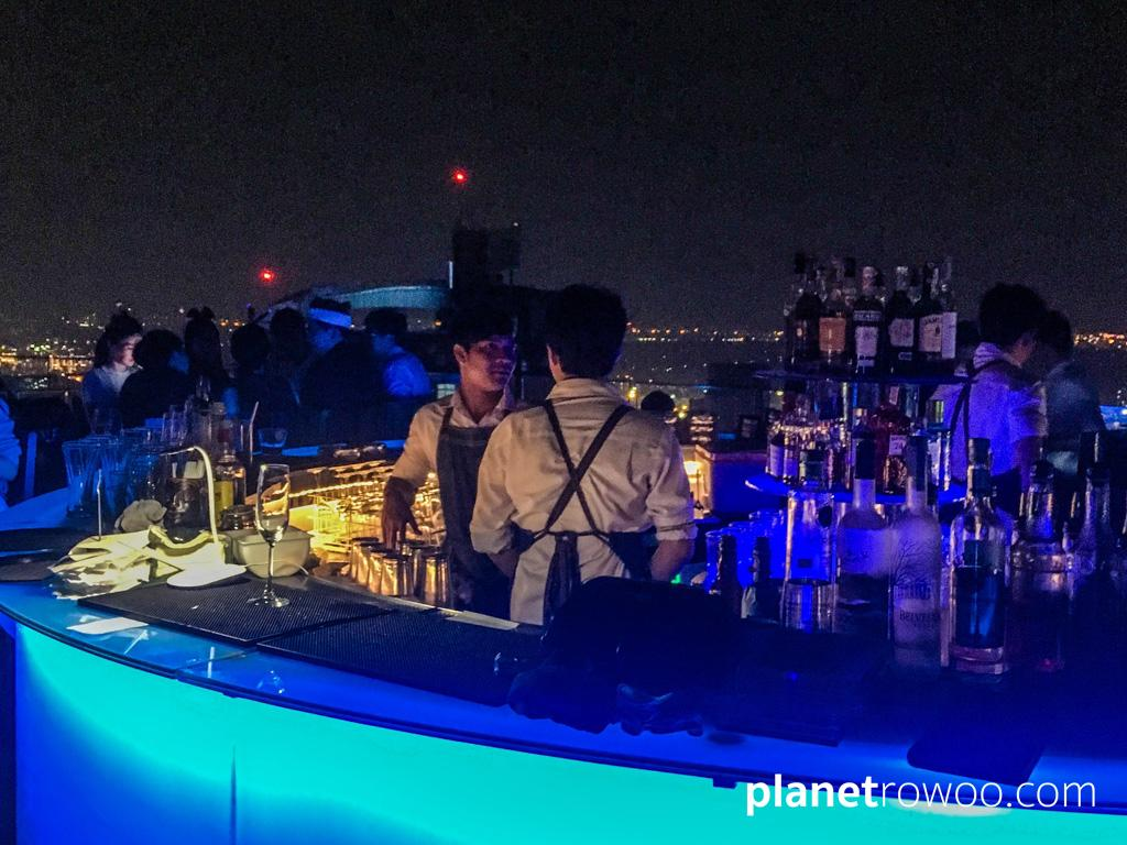 The illuminated bar at the Marriot's Octave Rooftop bar in Bangkok