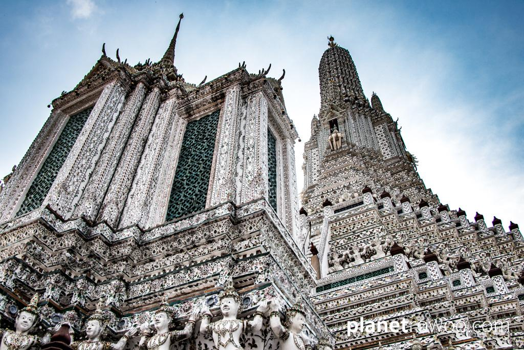 Glazed ceramic tiles and porcelain pieces adorn the Khmer style prang of Wat Arun in Bangkok