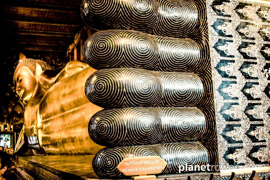 The golden Reclining Buddha at Wat Pho in Bangkok is 46-metres long from head to toe